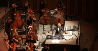 Jeff Mills performing with full orchestra at the Casa da Musica in Oporto (2015).