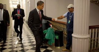 President Barack Obama fist bumps custodian Lawrence Lipscomb in the Eisenhower Executive Office Building (2009)