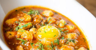 Goat Bolognese with potato gnocchi and egg yolk at Compère Lapin